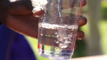 filling a cup with filtered water