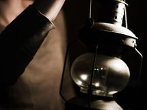 a girl holding a lantern