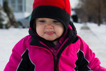 a toddler girl in a winter coat