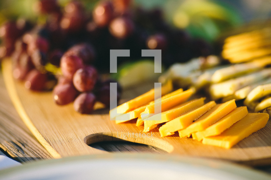 cracker and cheese plate with grapes