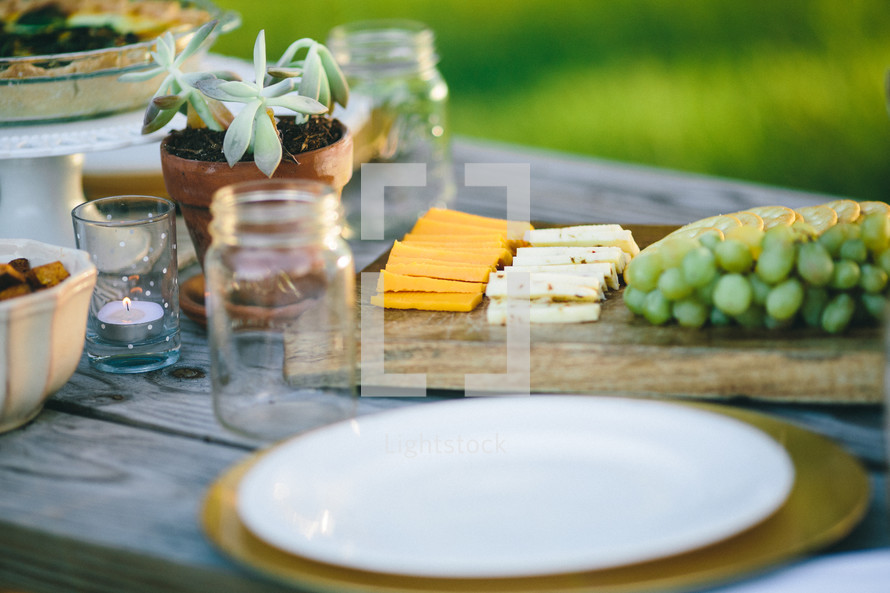thanksgiving place settings on an outdoor picnic table