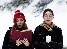 Christmas caroling in the snow