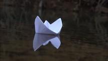 floating paper boat