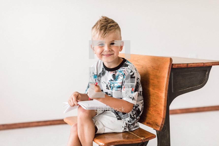 kid sitting at a desk