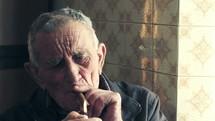 elderly man smoking a cigar