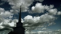 Cloud movement over the steeple of a church.