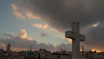 Time-lapse of cloud movement  over the Old City of Jerusalem at sunset.
