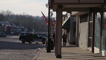 Compilation of American Flags around small town USA. Flags waiving downtown. US flag on a train. Red, white and blue flag with blue sky behind. Wheat / grass with American Flag waiving behind. Could be useful for pieces on US Missions, July 4th, Memorial Day, Veterans Day or  any patriotic video.