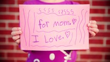 8 clips of a young girl making a Mother's Day Card