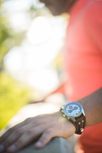 a man with a wrist watch