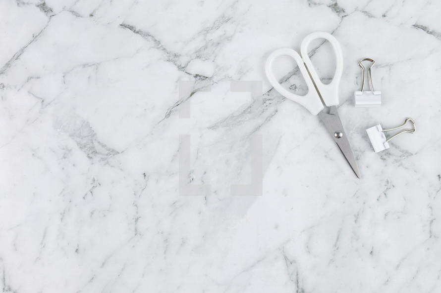 scissors and clips on marble