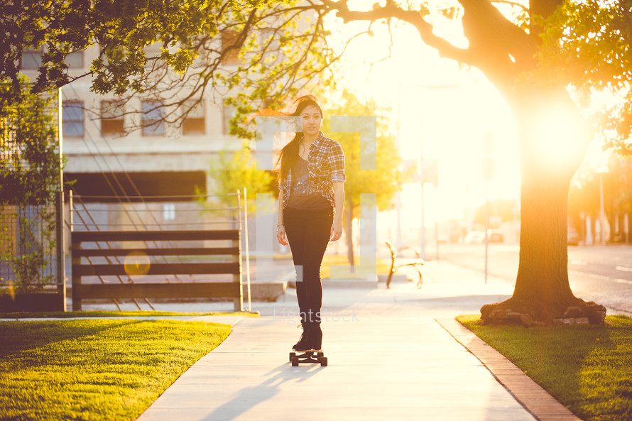 a young woman on a skateboard
