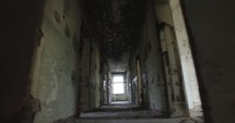 walking down a hall in an abandoned house
