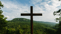 cross against a mountain