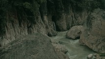 aerial view over a river in a canyon