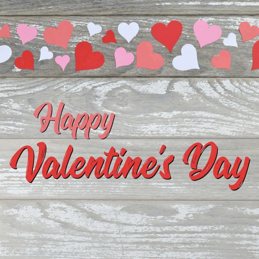 red and pink paper hearts on white wooden table