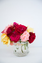 a vase full of roses