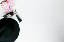 hat, sunglasses, keychain, and pink flowers