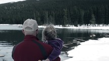 grandfather and granddaughter at the lake