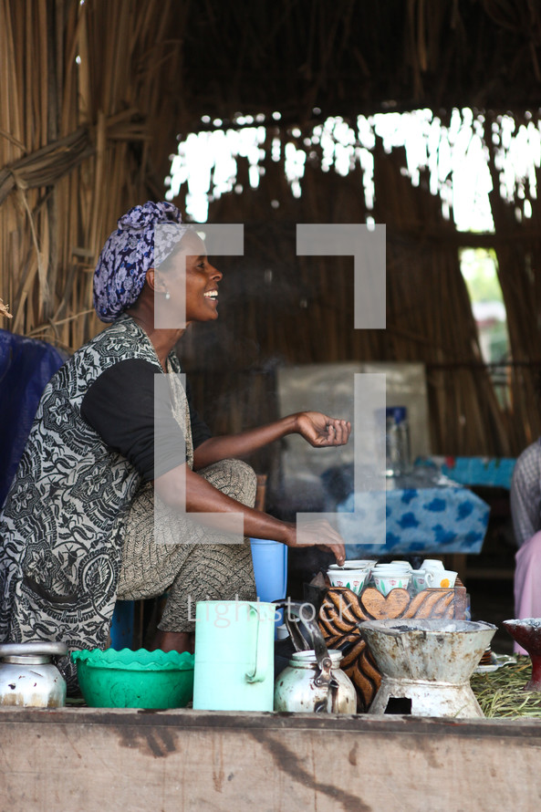 Ethopian woman cooking Zeway Food For The Hungry Ethiopia
