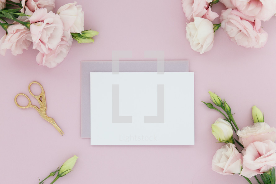 paper in the center surrounded by a border of pink flowers