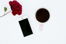 red rose, iPhone, and mug