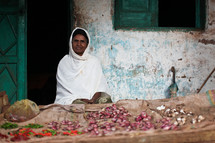 Ethiopian woman at a vegetable stand
