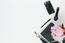 iPhone, watch, keychain, pen, notebook, and pink flowers border