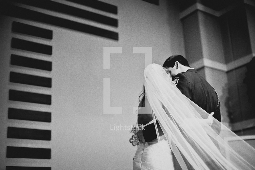 A bride and groom standing at the altar