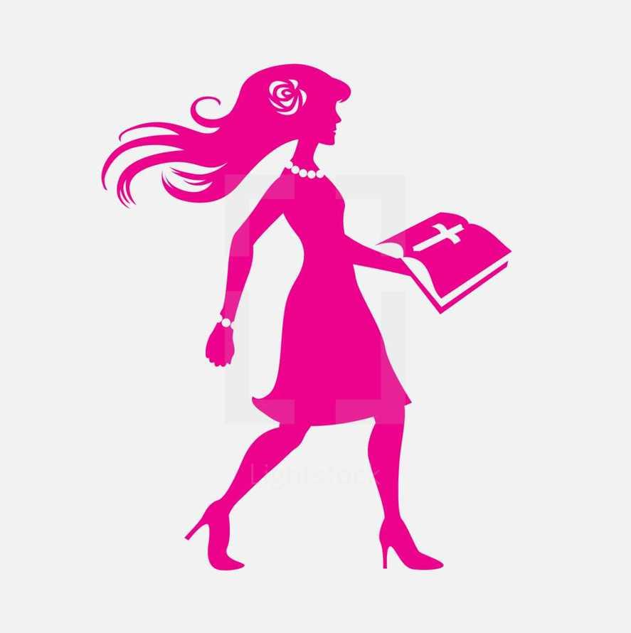 woman in pink walking carrying a Bible