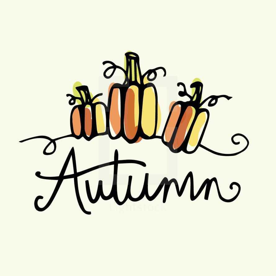 word Autumn and pumpkins