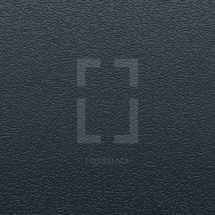 Black textured background. Leather or plastic surface. Dark material for book or notebook cover.