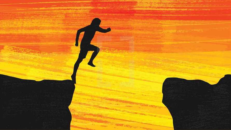 man taking a leap of faith over a gap