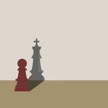 pawn chess piece with a king's shadow.