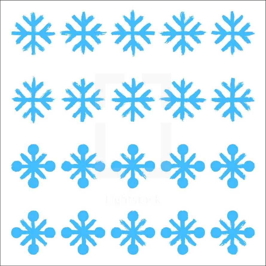 Snowflakes set 01. Twenty different hand-drawn of a snow flakes drawn by bold brush stroke
