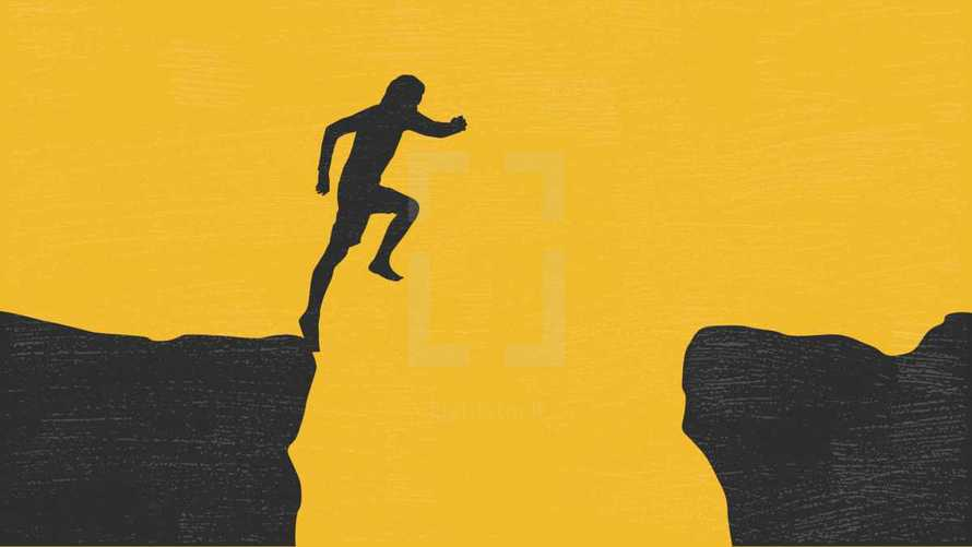 man jumping over a ravine