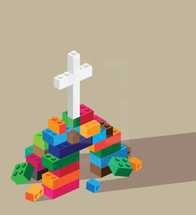 stack of legos and cross