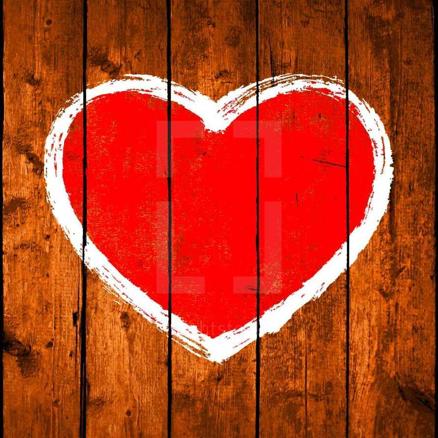 heart and arrow on wood